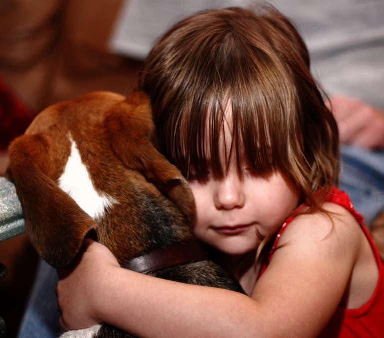 Child with beagle.